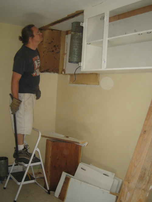 tearing out cabinets